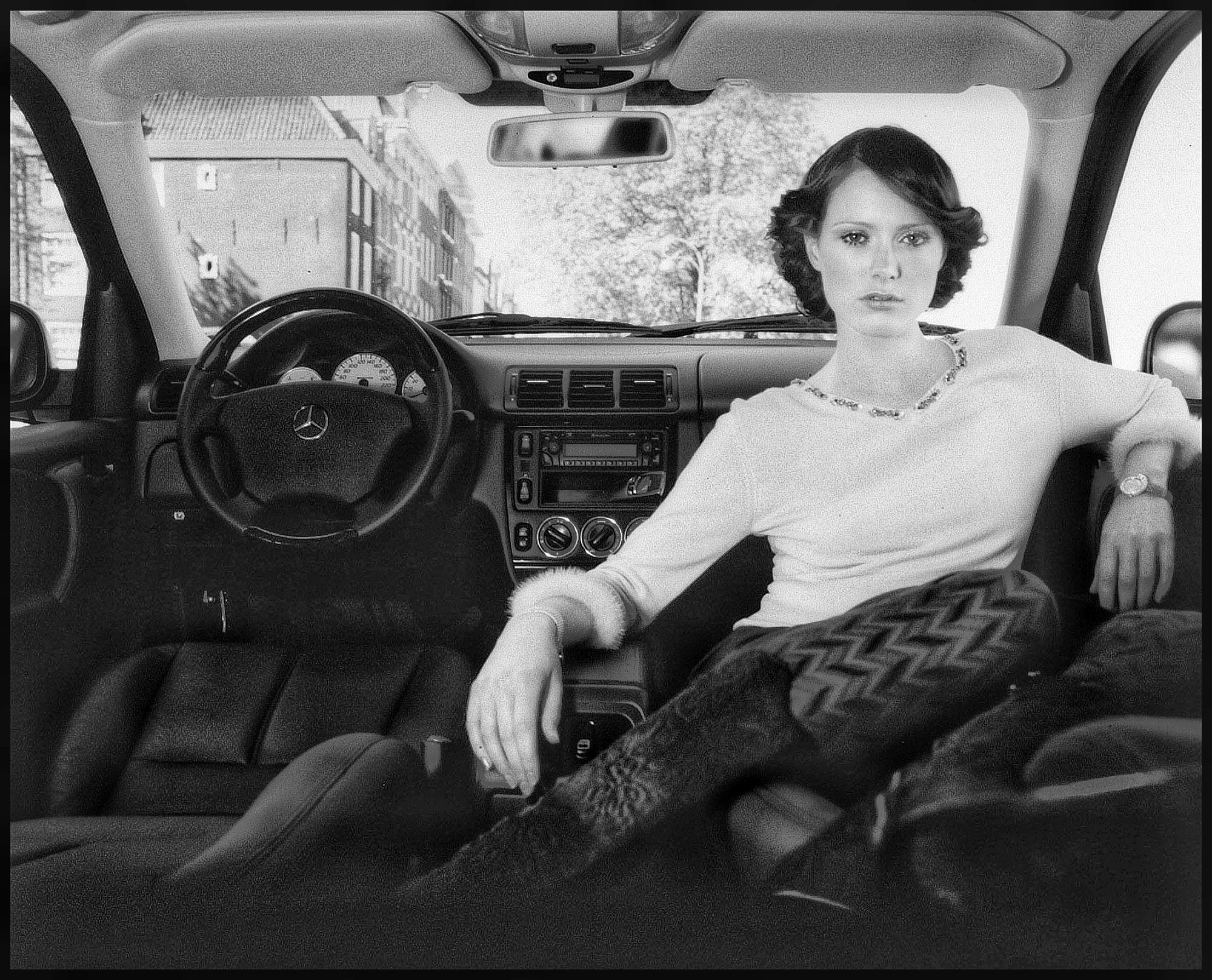 beautiful woman photography inside a car retro