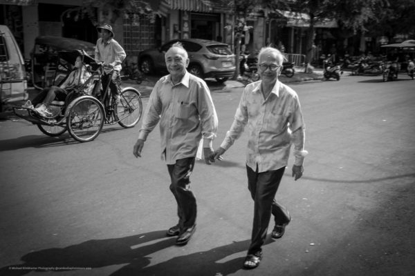 A beautiful image of 2 happy older men. Different cultures different habits.