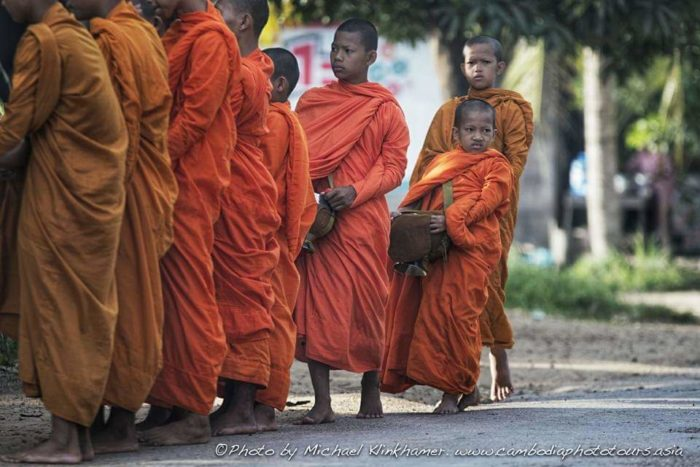 young boys buddhist alms collection cambodia